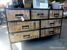 Here's some inspiration for a modern/industrial chest of drawers with the actual drawers (or at least the drawer facings) made with reclaimed wood from shipping crates.