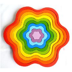 Simple yet effective, the colourful Stacking Rainbow Flowers Toy from QToys encourages motor skills and colour perceptions. Rainbow Flowers, Big Flowers, Organic Baby Toys, Wooden Rainbow, Children's Boutique, Baby Play, Wood Toys, Toy Store, Kids Decor