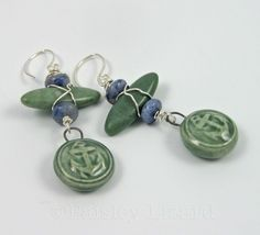 Emerald green glazed porcelain anchor charms are the focus of these nautical theme earrings. The anchor charms dangle from green marble and blue aventurine beads wrapped in non-tarnish silver-plated wire.