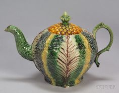 Staffordshire Lead Glazed Creamware Cabbage Leaf Teapot, England, ca. 1760, translucent polychrome enamels, pineapple molded cover, ht. 4 7/8 in.