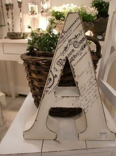 Mod podge a copy of your marriage certificate to your last name initial. craft-ideas