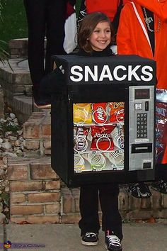 Lauren: My 8 year old daughter is wearing the vending machine costume I made. I used a large U-Haul Box with a smaller U-Haul box inside to hold the snacks and...