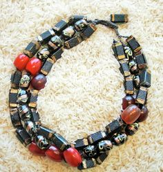 Twiga Gallery Designs    'Splendor' Necklace.  Antique Czech Art Deco Glass beads, combined with North African copal amber, Venetian Glass beads with Adventrine from the African Trade and antique Ethiopian Amber.