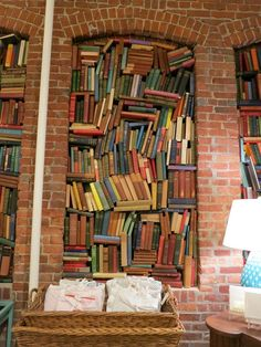 """This one looks like another of those """"books as artifacts"""" installations, not at all a practical way to store books for easy retrieval, that's for sure."""