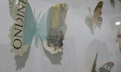 Butterfly cut outs from newspapers