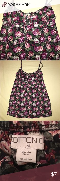 Cotton on floral tank So cute! Ties in the front. Starts are adjustable. Strip of Ruffle at top of shirt. Colors are beautiful & in great condition! Needs a little ironing & it'll look perfect! Cotton On Tops Tank Tops