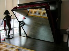 Awesome idea for the guestroom/ workout room: murphy bed! With a large mirror underneath for yoga when stored away ♥