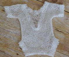 Newborn Lace Romper, Newborn Bodysuit, Photography Prop, Newborn Photo Prop, Open Back Romper, Vintage Newborn Romper, White Romper, Sewn  -------- *Processing time: Please allow 1-2 weeks for your item to be handmade before shipping.*  This beautiful white lace romper will make the perfect addition to your newborn photo shoot. Each romper is sewn by me using gorgeous stretch lace and dainty lace trim. The design features a deep v-cut open back. Meant to fit snuggly - sized to fit average…