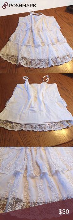 Lace tank Tiered white lace tank. Cotton back. Never worn without tags. Midnight velvet Tops Tank Tops