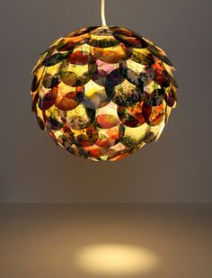 Artichoke Mixed Floral Pendant Light  Hanging by Zipper8Lighting. These lights are gorgeous!