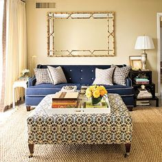 great blue sofa with white piping and patterned ottoman. #KBHome