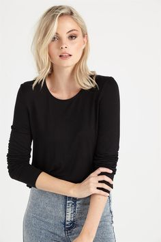 Stay cute and comfy in this long sleeve crop designed to pull together any look.<br />Back zipper detail and dreamy fabric elevates this wardrobe basic to suit day or night.<br /><br />  - Hip grazer length<br /> - Standard length<br /> - Long sleeve top<br /> - Rounded neckline<br /> - Straight hem line<br /> - Striped pattern<br /> - Bold solid colours<br /> - Knitted fabric<br &...
