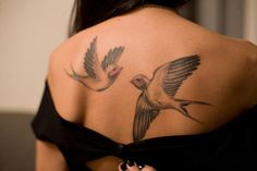 Swallow back tattoo - 50 Lovely Swallow Tattoos  <3 <3
