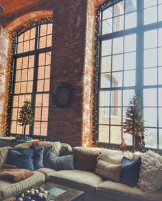 Cozy loft style apartment - christmas decor. Exposed brick wall with tall ceilings and stained concrete floors. Old cotton mill.