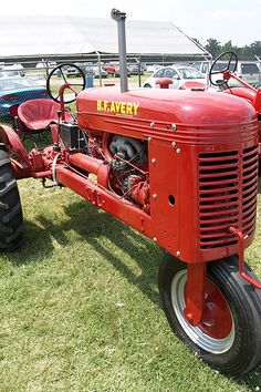 An old (likely late 1930's-mid 1940's) row crop, single wheel tricycle  tractor