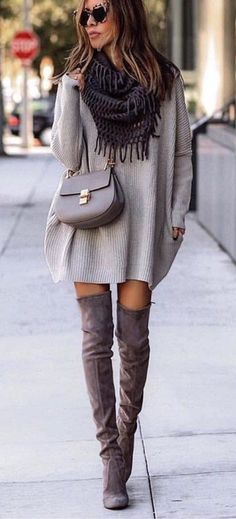 #fall #outfits  women's black fringe scarf, gray long-sleeve mini dress, pair of brown knee high boots, and gray leather cross-body bag outfit