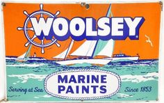 Large beautiful sign for Woolsey Marine Paints showing sail boats crossing the sea.