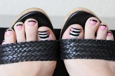 Pink black and striped nails  I always have to have my toenails painted whether they are seen or not! It just makes me feel better. The fun thing about painting nails is there is no limit to what you can do! Any crazy color, bold design or print will look good on anyone and its just fun! So here is my Valentines inspired toes.