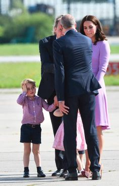 Britain's Prince William Duke of Cambridge and his wife Kate the Duchess of Cambridge walk with their children Prince George and Princess Charlotte...