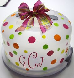 Personalized cake carrier.  Love the colors.  Coordinating bow adds a nice touch, too.