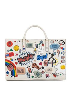 """Pop art handbag by Anya Hindmarch.  Ebury Sticker-Print Leather Tote Bag w/ rolled top handles & open top. Expandable snap-button sides. Inside, suede lining and zip pocket. 11 3/4""""H x 16 1/2""""W x 7 1/2""""D. Made in Italy."""