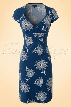 This 60s Gina Antibes Dressis a real vintage beauty which is suited for every body type thanks to the A-line style and fixed wrap over.The soft, stretchy, dark blue viscose blend with cream coloured graphical floral print is truly a joy to wear. Comfortable and playful with a sexy twist, what else could you wish for?!Pregnant? Then you're all set with this stunner!   Diamond shaped neckline Cap sleeves Wrap over No zipper or buttons Hits just above the knee with a height of...