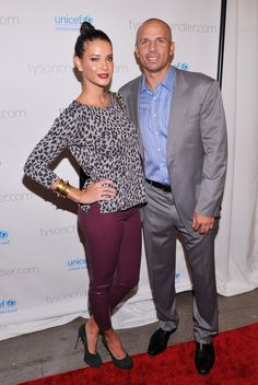 You can tell that Jason Kidd is a new Knick and is a veteran just based on the rather conservative grey suit and blue shirt he chose to wear to attend Tyson Chandler's event. His wife, Porschia Coleman was a little more adventurous in her outfit choice but we like her purple pants, leopard print, black pumps, dark lip, gold bracelet and high bun. Can't wait for the NBA season to start to see how JKidd does with the Knicks!