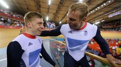 Chris Hoy of Great Britain celebrates with Philip Hindes after setting a new world record and winning gold in the men's Team Sprint Track Cycling final on Day 6 of the London 2012 Olympic Games at Velodrome