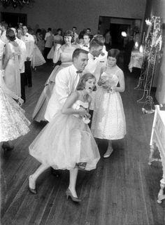 Fun at the debutante ball, 1950s.