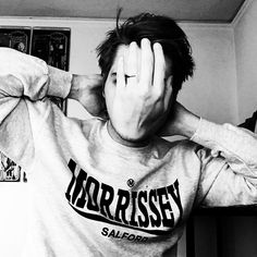my favorite picture of Gerard Way. seriously though. adorable pose. morrissey shirt. his hair. then that ridiculous hand covering his face.