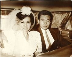A handsome couple in the backseat. | 60 Adorable Real Vintage Wedding Photos From The '60s