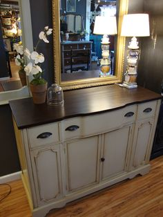 This classic Duncan Phyfe buffet was painted in a stone color and glazed in dark brown. The top was stained dark brown with matching hardware.