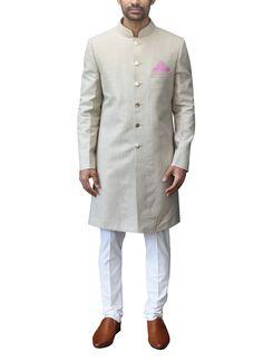 Buy stylish Indian men's sherwani suits in a range of styles including appliqué sherwanis, embroidered sherwanis and wedding sherwanis online. Indian Fashion Designers, Indian Designer Outfits, Indian Outfits, Indian Groom Wear, Indian Wedding Wear, Wedding Dress, Groom Outfit, Groom Attire, Mens Sherwani