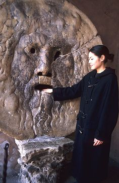 """Legend has it that if one tells a lie with one's hand inside La Bocca della Verita (""""The Mouth of Truth""""), it will be bitten clean off. Head to the church of Santa Maria in Cosmedin on the banks of the Tiber to put the myth to the test."""