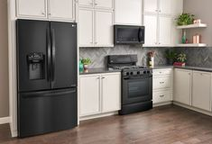 Matte black appliances are timeless and go with any style. For an instant matte black makeover, shop LG Matte Black Kitchen Appliances at Best Buy. White Appliances, Stainless Steel Kitchen Appliances, White Kitchen Cabinets, Kitchen With Black Appliances, Black Kitchen Countertops, Cuisines Design, Black Kitchens, New Kitchen, Kitchen Ideas