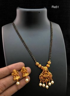 Beautiful balck bead chain with lakshmi devi pendant. Pendant studded with multi color stones and pearl hangings. 15 May 2018 Black Diamond Chain, Black Diamond Jewelry, Antique Jewellery Designs, Gold Jewellery Design, Stylish Jewelry, Fashion Jewelry, Pearl Necklace Designs, Gold Necklace, Gold Mangalsutra Designs
