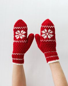 This is a pair of red and white mittens with a fair isle style pattern. This pair was hand knit on 4 knitting needles out of very soft 100% super wash