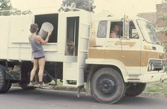 Garbo - remember when your garbage was collected and emptied by a bloke in ruggers and footy socks?