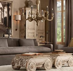 Oh yeah! i love the use of the ionic scrolls for coffee table! where can i get these.