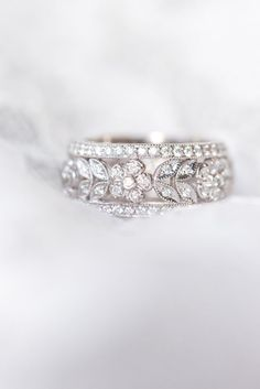 @pennypreville's garland floral wedding ring features white gold and pave diamonds. Floral designs on wedding rings are a big bridal trend. This ring would look beautiful with a simple whit gold and diamond engagement ring.