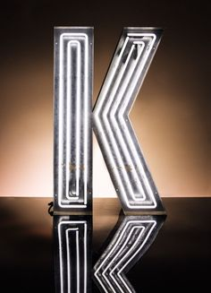 Neon light up letter with metal casing.