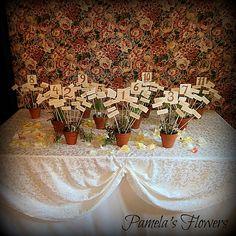 Reception Decorations by Pamela's Flowers - See more designs at http://pamelasflowers.wix.com/weddingsbypamela #weddingflowers #harrisburgflorist #reception #weddingreception #receptionflowers #weddingdecorations #centerpieces #weddingcenterpieces #weddingarrangements