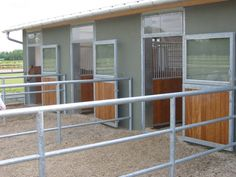 "Dark finish to stable yard with ""paddocks"".  http://www.allemann-gmbh.de"