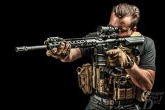"""I read somewhere that to be popular on Pinterest, you must """"be extremely stylish,"""" so I found this picture our photographer, Martin took of a Texas Black Rifle AR."""