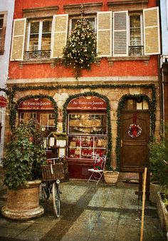 France...enchanting Shop, but trying to figure out how they have a Christmas tree coming out the upstairs window