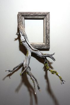After selecting a unique, antique frame, Darryl Cox (of Fusionframesnw) spends the day searching for the perfectly gnarled piece of wood to blend into the original frame.