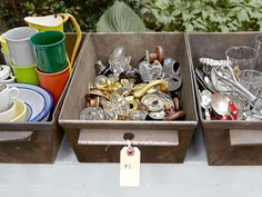 """Avoid pricing every little thing. Sort goods in bins, like these metal breadboxes (pictured above), and stick a single ""for each"" tag on the lot. If you must mark all your gear, opt for color-coding with labels, and then tack up a prominent key that notes each hue's corresponding cost"""