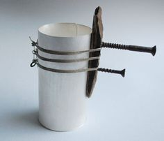 Silver Vessel with found screws and wood bound on with antique Belfast linen thread. Stuart Cairns