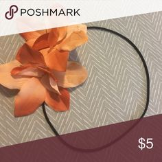 Flower Headwrap Orange flower headwrap on a stretchy band. Only worn a couple of times. Accessories Hair Accessories