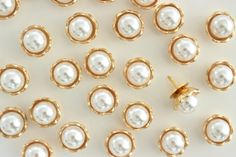A personal favorite from my Etsy shop https://www.etsy.com/listing/264897430/ivory-pearl-in-golden-shell-thumbtack
